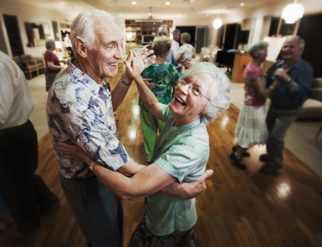 two senior people dancing