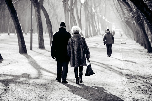 two seniors walking in winter time