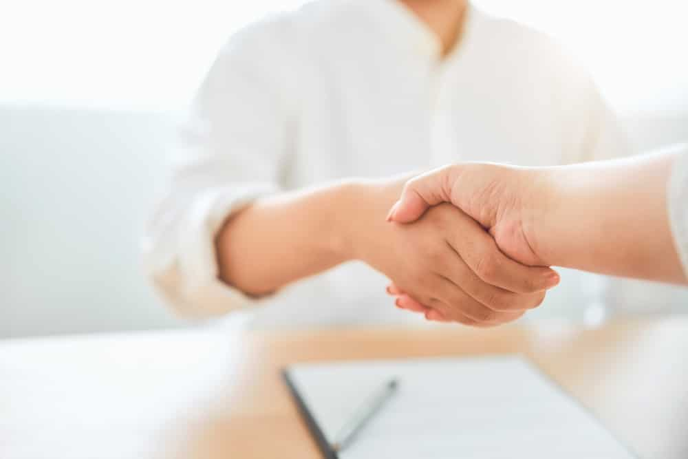 Close up of partnership handshake successful after negotiating business. Connection deal concept.