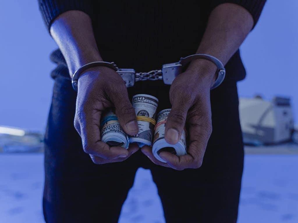 Handcuffed with dollars